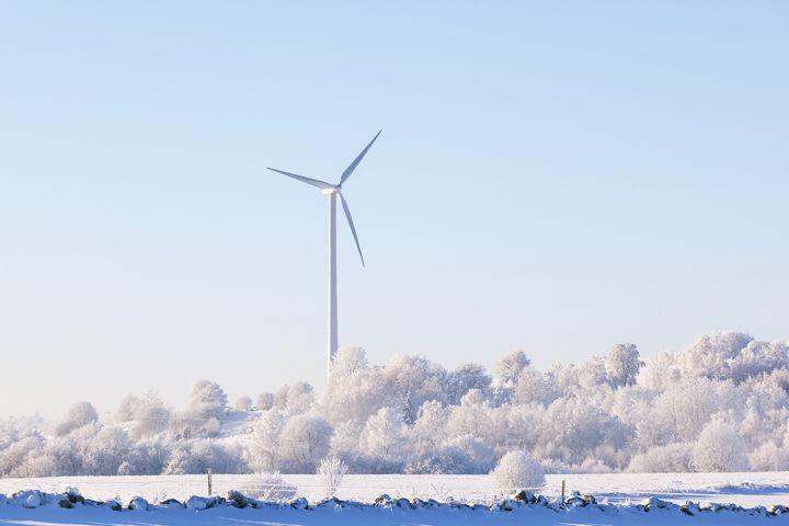 Winter landscape with wind turbine